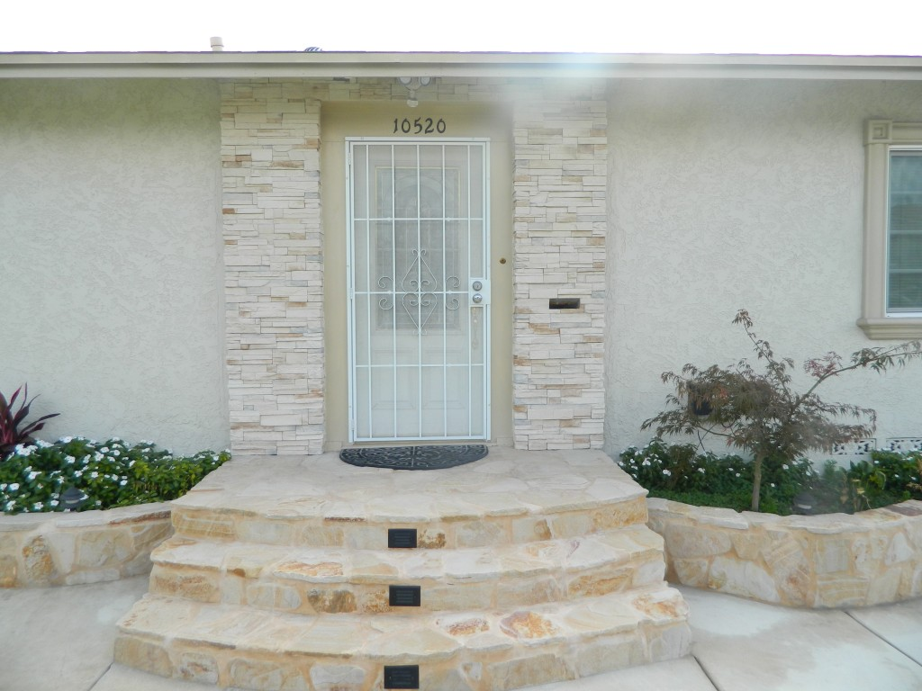 River rocks layed around doorway by Generations Construction